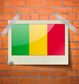 Flags Mali scotch taped to a red brick wall vector image