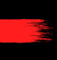 smear of red paint on a black background vector image