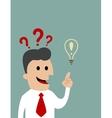 Businessman pointing toward a light bulb vector image