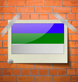 Flags Komi scotch taped to a red brick wall vector image