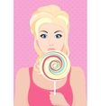 Beautiful blond model girl with big candy sweets vector image