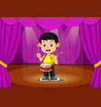 cute boy playing drum on stage vector image