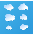 cute cartoon paper or plastic cloud shapes on blue vector image