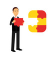 businessman character assembling colorful jigsaw vector image
