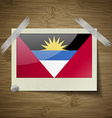 Flags of Antigua and Barbuda at frame on wooden vector image