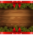 Christmas tree with red bow on the wood background vector image