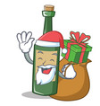 santa with gift wine bottle character cartoon vector image