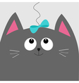 Gray cat head looking at blue bow hanging on vector image