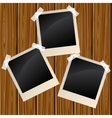 Blank photos on a wooden wall vector image vector image