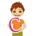 little boy holding the c letter vector image