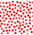 seamless red plus sign pattern vector image