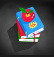 top view of apple on pile of books vector image