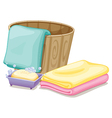 A pail with towels and a soap in a soap box vector image