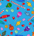 Seamless candy pattern over blue vector image