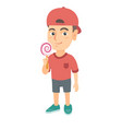 little caucasian boy holding a lollipop candy vector image
