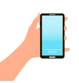 Hand holding smart phone on blue background vector image