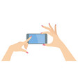 woman hands holding smart phone horizontally vector image