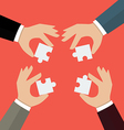 Businessmen insert jigsaw pieces together vector image