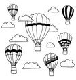hand drawn of hot air balloons and clouds on vector image