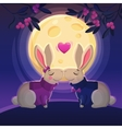 Two kissing rabbits on the moon background vector image