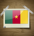 Flags cameroon at frame on wooden texture vector image