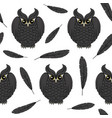 seamless pattern with black owls and and feathers vector image