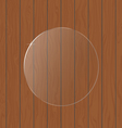 Round glass on a wooden background vector image