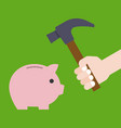 hand holding hammer prepare for crashing piggy vector image