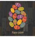 easter eggs composed on wooden background vector image