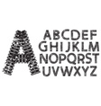 alphabet letters made from tank and tractor tracks vector image