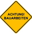 Yellow and black achtung bauarbeiten sign vector image vector image