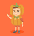 caucasian boy in a halloween pumpkin costume vector image