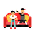 two young male friend sitting on sofa and playing vector image
