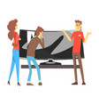 couple choosing wide tv with shop assistant help vector image