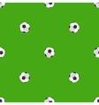 Soccer balls over green field seamless pattern vector image