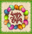 multi colored easter eggs and grass on a wood vector image