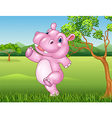 Cartoon hippo running and happy in the jungle vector image