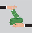 hand giving many bunches of money to other hand vector image vector image
