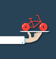 hand holding bicycle on dish vector image