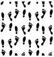 Black and white human feet prints seamless pattern vector image