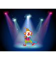 A clown at the stage with spotlights vector image