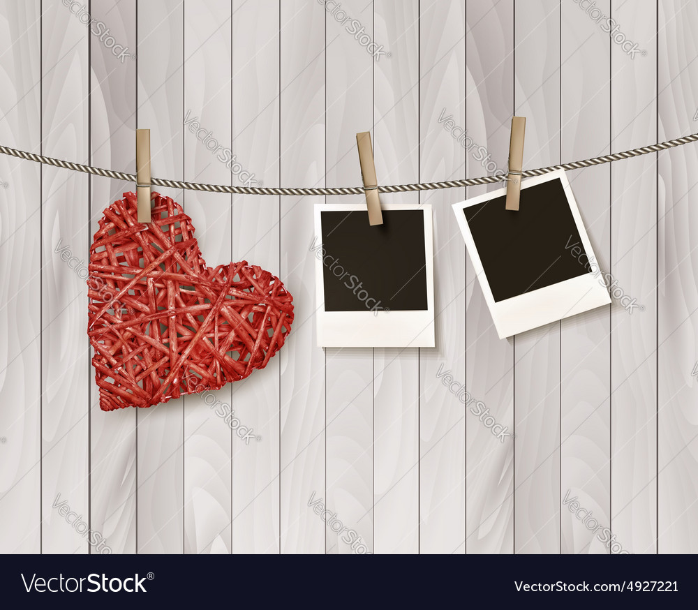 Red wooden heart with photographs vector
