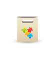 paper bag with puzzle symbols vector image