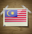 Flags Malaysia at frame on wooden texture vector image