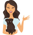 young woman holding a dog vector image