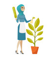 young muslim housemaid watering flower with spray vector image