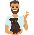 young man holding a dog vector image