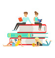 micro young women and men sitting on a pile of vector image