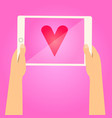 hands holding tablet and show red heart on screen vector image