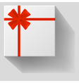 Gift with red bow with ribbons vector image